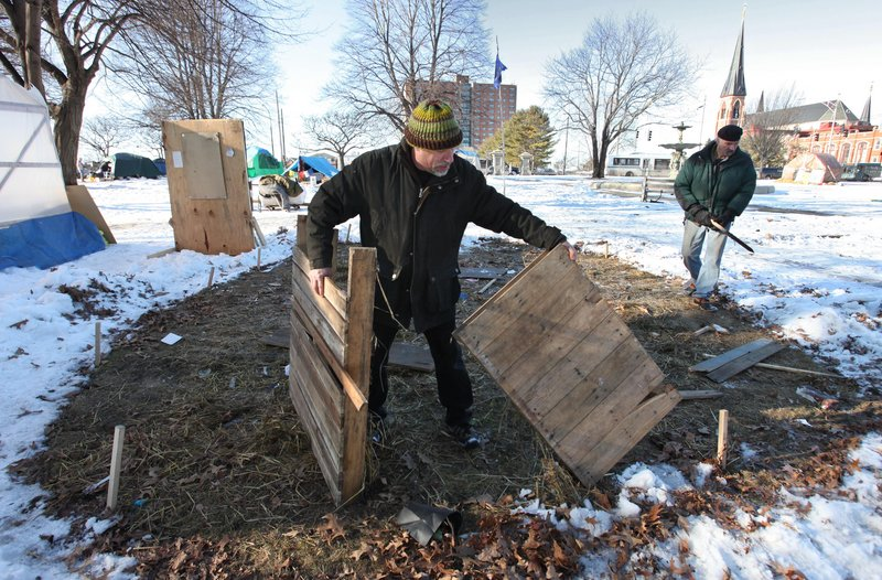 Michael Shaughnessy, left, and Steve Demetriou pick up in Lincoln Park Saturday.