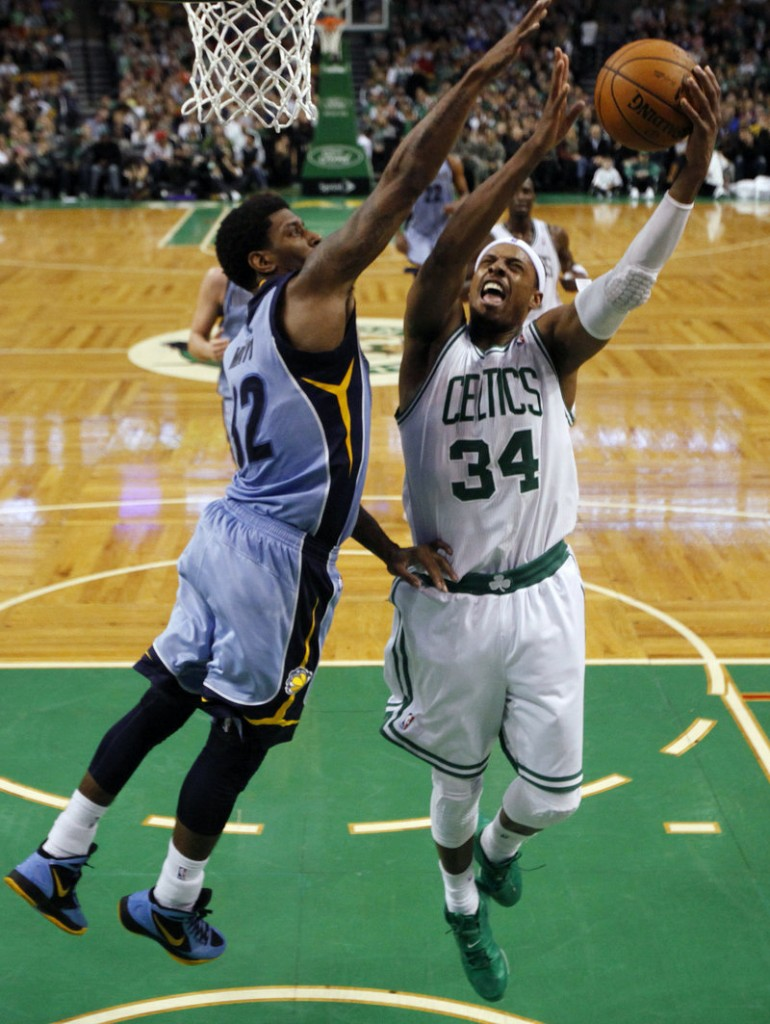 Paul Pierce goes up for a shot against O.J. Mayo of the Grizzlies during the Celtics' 98-80 victory Sunday.