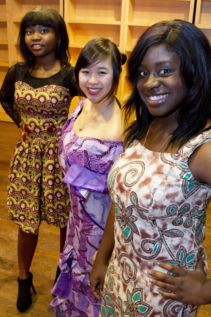 First-year Bates College students Folarera Fasawe, Michelle Pham and Nicole Kanu model contemporary Nigerian clothes, which will be featured in Friday's Inside Africa Fashion Show at the college.