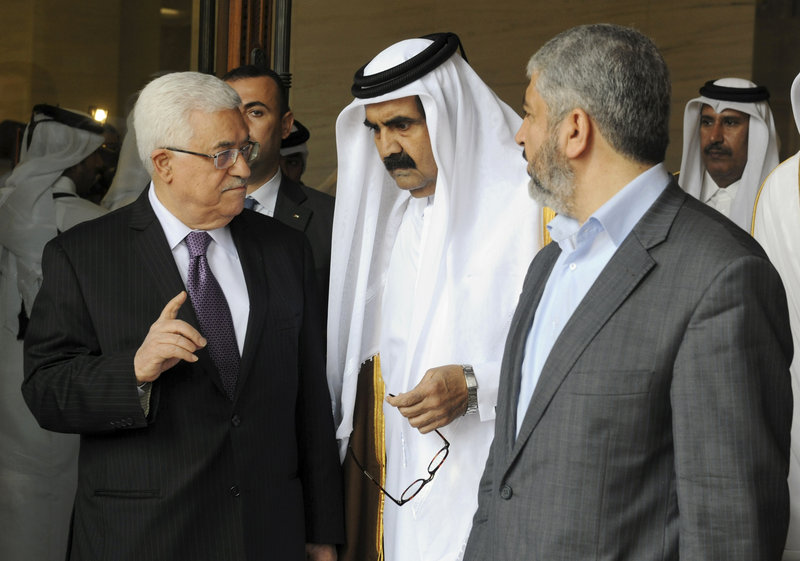 Palestinian President Mahmoud Abbas, left, and Khaled Mashal, chief of the Islamic militant group Hamas, right, confer with Qatar's crown prince Sheik Tamim Bin Hamad Al Thani during a meeting in Doha, Qatar, on Monday.