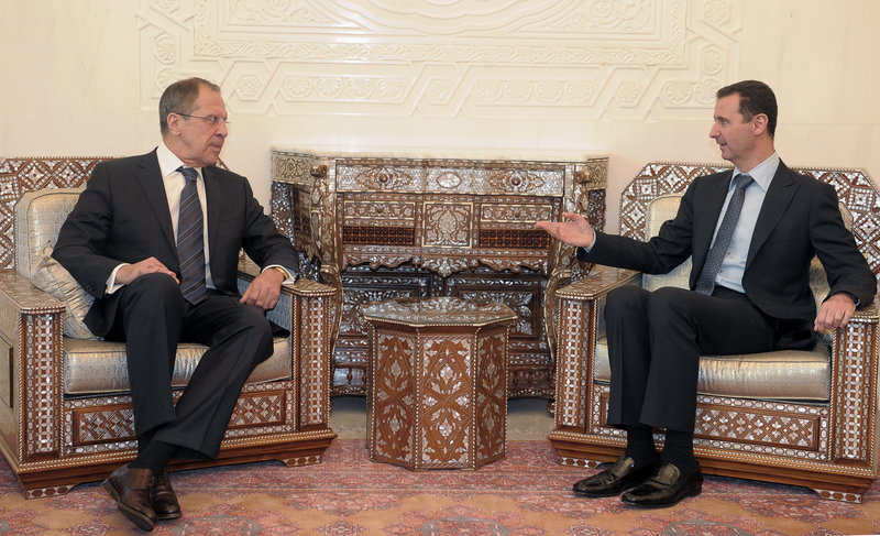 Syrian President Bashar Assad, right, meets with Russian Foreign Minister Sergey Lavrov in Damascus, Syria, on Tuesday. Syrian forces have renewed their assault on the city of Homs.