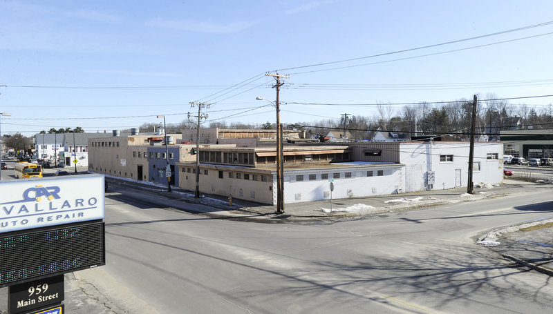 The city of Westbrook has hired an architect to design a building for the site of the former Maine Rubber Co. downtown. The city has been trying to redevelop the site for years.