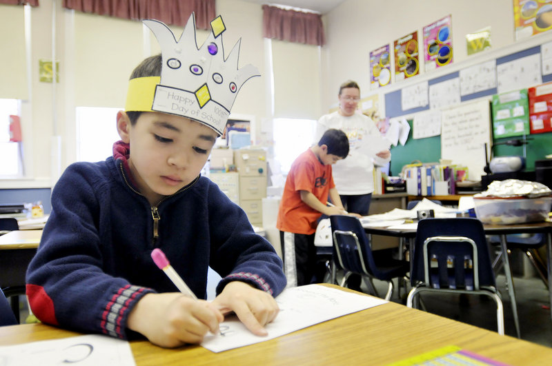 Isaac Steward, 7, fills out a worksheet during Debbie Waugh's second-grade class at Greater Portland Christian School in South Portland last week. State education officials say that many religious schools wouldn't have to follow the Maine Learning Results to qualify for public funding, though meeting other criteria might be too expensive and time-consuming to make it worthwhile.
