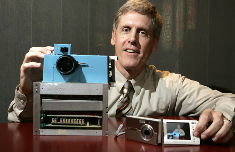 Steven Sasson, then Eastman Kodak Co. project manager, shows the prototype digital camera he built in 1975 next to a Kodak EasyShare One at Kodak headquarters in Rochester, N.Y., in 2005.