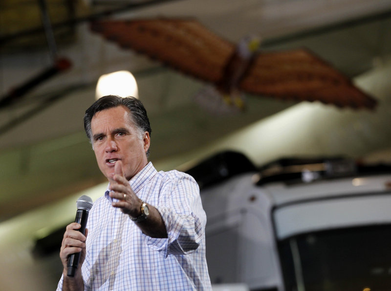 Republican presidential candidate Mitt Romney speaks at a campaign rally in Atlanta on Wednesday. He will be in Maine for a rally at 6 p.m. today.
