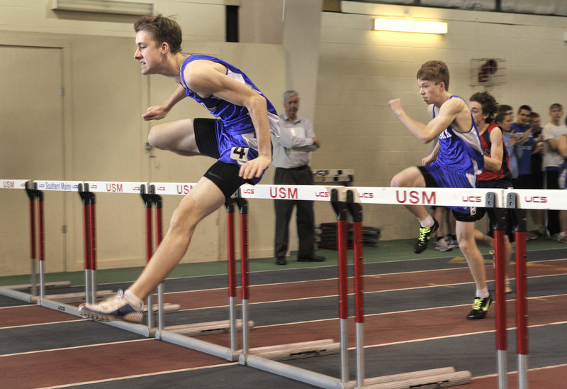 Tom Reid of York clears the final hurdle on his way to a second-place finish in the 55-meter hurdles. Reid also won the triple jump and placed second in the long jump.