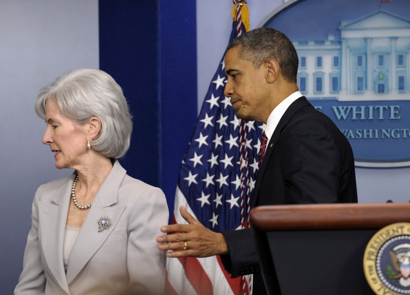 President Obama and Health and Human Services Secretary Kathleen Sebelius leave their news conference Friday.