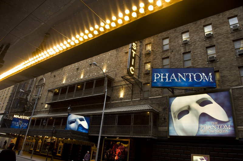 """The Majestic Theatre, above, celebrated the 10,000th performance of """"The Phantom of the Opera"""" with a giant cake and a curtain call."""