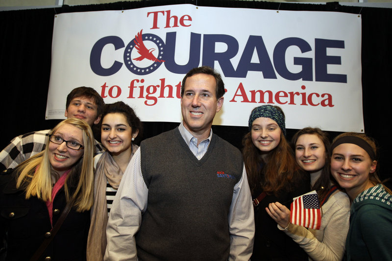 Republican presidential candidate Rick Santorum poses for a photo with supporters after speaking at a rally Tuesday in Coeur d'Alene, Idaho.