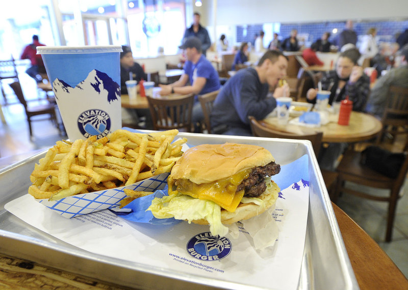 A cheeseburger, fries and a Coke at Elevation Burger in South Portland.