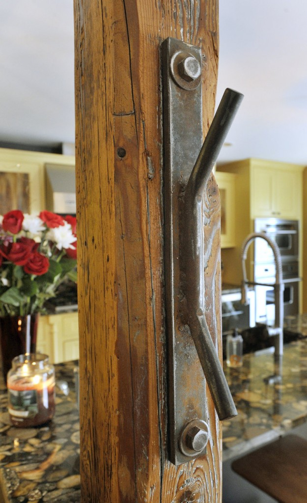 An original barn tie-up can now hold items such as shopping bags. The Richardsons kept as many of the original wood beams as possible.