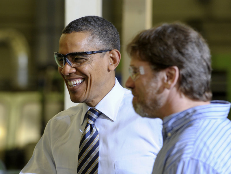 President Barack Obama tours a factory earlier this month. The president has proposed a plan to significantly lower the tax rate on American corporations. (AP Photo / Susan Walsh)