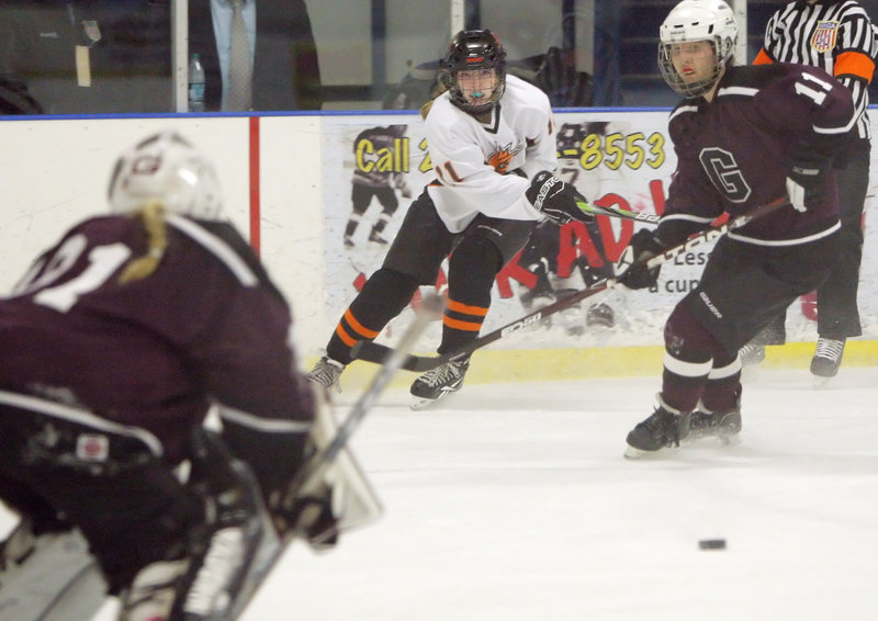 Gillian Ford of Brunswick watches her shot head toward the net against Greely. Ford had one of Brunswick's goals.