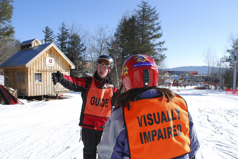 Liam Gillis, a Gould Academy junior, helps instruct a visually impaired skier at Sunday River. Gillis helped Gould Academy set up the portion of its ski instructor program that works with Maine Adaptive Sport. Gould's ski instructor program has taught local children for 25 years.