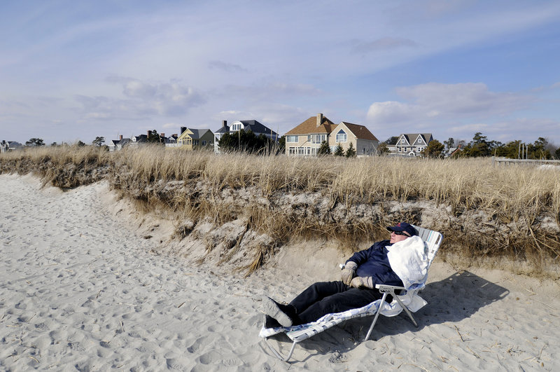 Louis Bilodeau of West Poland takes advantage of Thursday's nice weather by enjoying the sun in a beach chair at Pine Point Beach in Scarborough.
