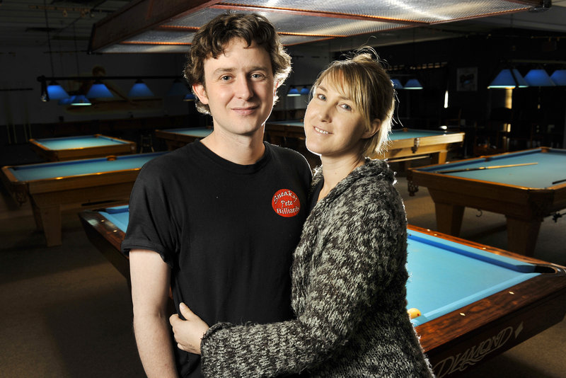 Gareth Steele and his wife, Jacqueline, hope their income from Sneaky Pete Billiards in Windham will help finance Steele's career as a professional pool player.
