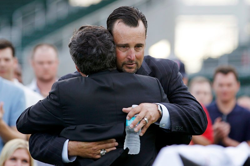 Tim Wakefield embraces Tom Werner, the Red Sox chairman, before announcing his retirement.
