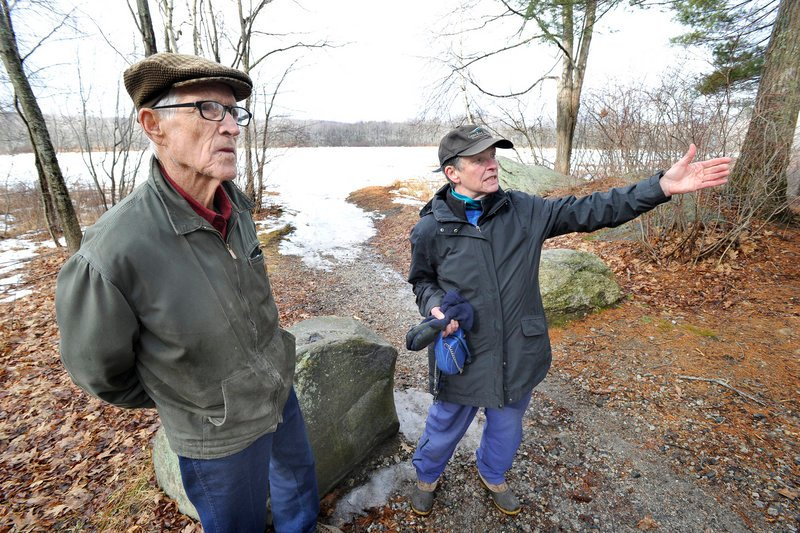 Ralph Johnston of Windham and Julie Motherwell of Falmouth respectfully differ over whether to improve access for bigger boats to use Highland Lake.