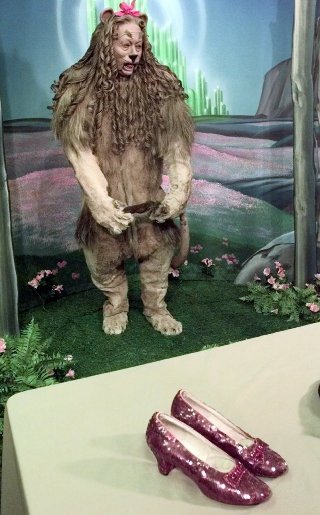 Dorothy's ruby slippers and the Cowardly Lion costume worn by Bert Lahr are displayed in New York in 2000.