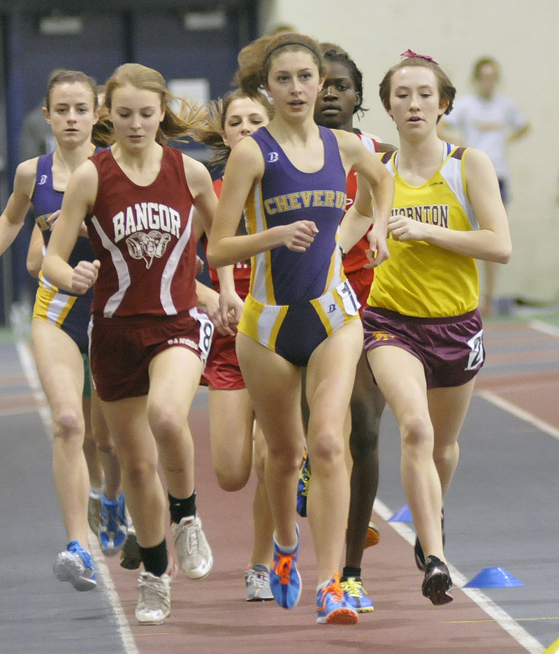 Fiona Hendry, center, of Cheverus leads in the mile with Bangor's Angelyn Masters and Thornton Academy's Charlotte Pierce at her side at the Class A state meet. Hendry won the event in 5:16.20.