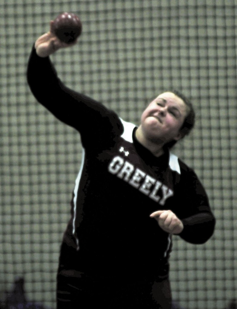 Catherine Fellows of Greely competes in the girls' shot put during the Class B state meet in Lewiston. Her top throw of 33 feet, 4 1⁄2 inches was good enough to win the event.