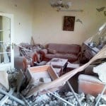 An image taken Monday by a citizen journalist and provided by a Syrian opposition group depicts damage done to a home in Homs by Syrian government forces shelling.