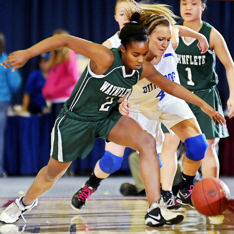 Rhiannan Jackson, left, of Waynflete looks to beat Melissa White of Madison to a loose ball during their Western Class A quarterfinal at the Augusta Civic Center. Seventh-seeded Waynflete came away with a 56-39 win.