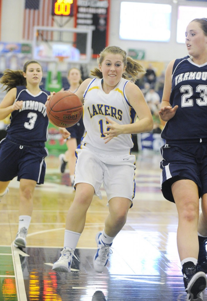 Sarah Hancock of Lake Region takes the ball to the basket on a fast break against Morgan Cahill of Yarmouth. Lake Region won, 60-34.