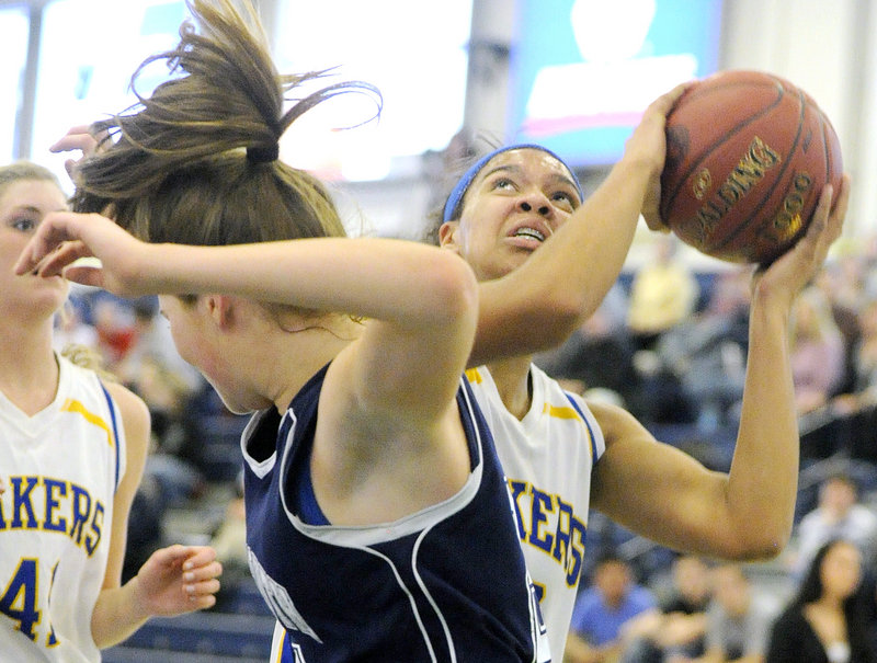Tiana-Jo Carter of Lake Region prepares to go up with a shot after hauling down an offensive rebound against Yarmouth. Lake Region won and will take on Leavitt, the defending state champion, in the Western Class B semifinals.