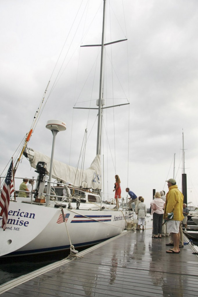 Visitors board Dodge Morgan's American Promise in August 2011 during a special Portland ceremony that paid tribute to Morgan on the 25th anniversary of his solo voyage around the world. The boat is now tied up at a Kittery marina.