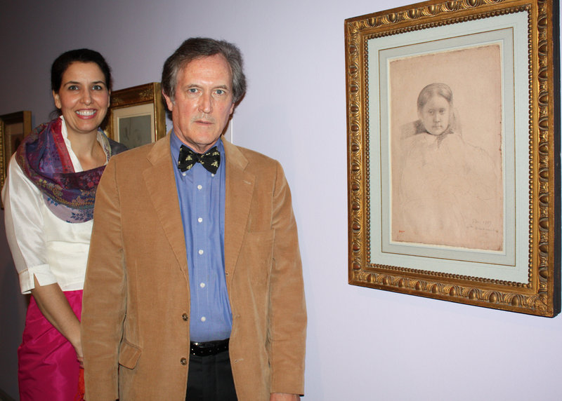 "Margaret Burgess, the Portland Museum of Art's European art curator, and collector Robert Flynn Johnson with ""Mlle Dembowska"" by Edgar Degas."