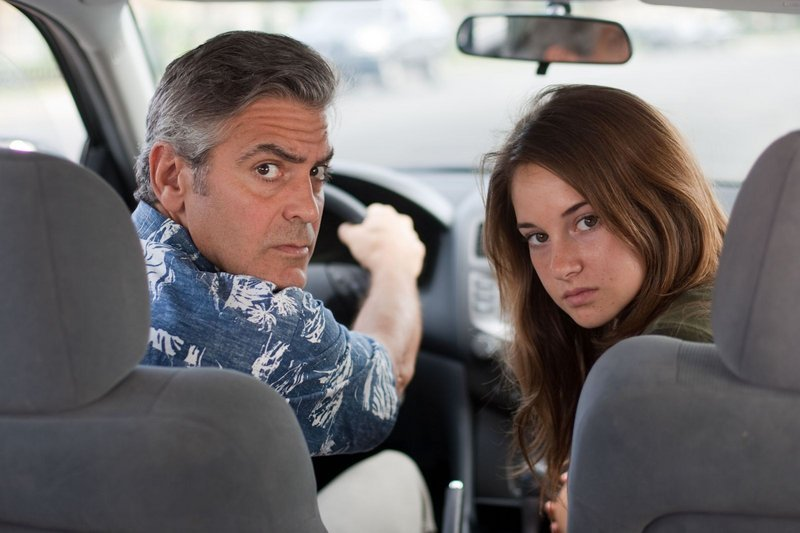 "George Clooney as Matt King and Shailene Woodley as Alex in ""The Descendants."" Clooney is up for Best Actor for this movie, and for Best Adapted Screenplay for ""The Ides of March."""