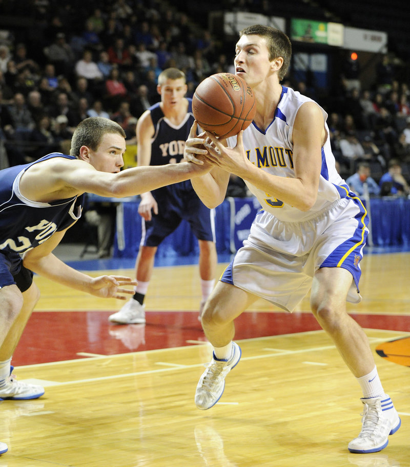 Aaron Todd of York pokes the ball from Jack Cooleen of Falmouth during their Western Class B semifinal. Falmouth remained undefeated, winning 49-45.