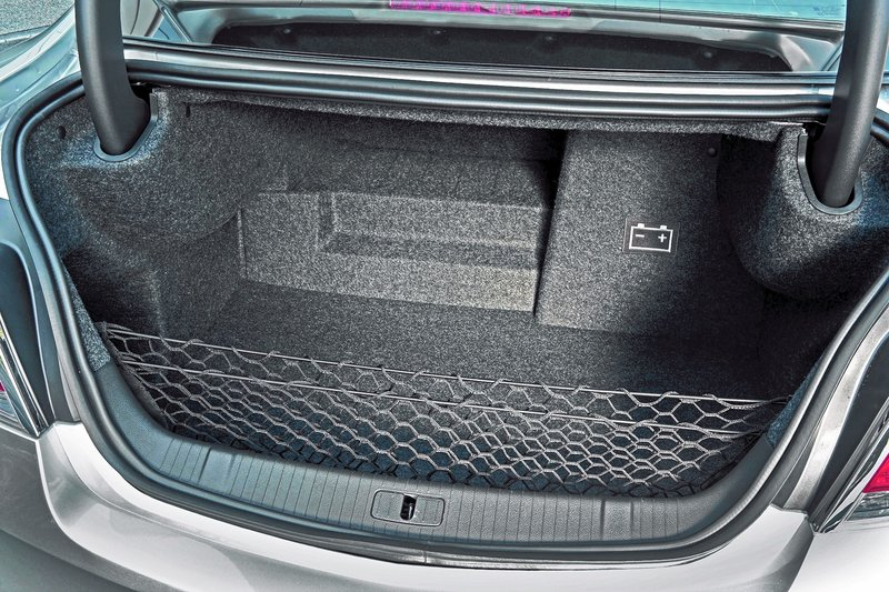 Although the stylish LaCrosse provides ample passenger room, cargo space is tight on models equipped with GM's hybrid eAssist powertrain.