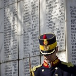 An honor guard soldier in Bucharest, Romania, stands at a monument at a Jewish cemetery with the names of Jews killed 70 years ago when the SS Struma was sunk.