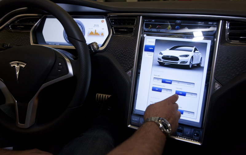 Tesla's Motors' upcoming Model S will feature a 17-inch touch screen. Within five years, more than 90 percent of new cars will come equipped with Internet-connected technology features, one expert predicts.
