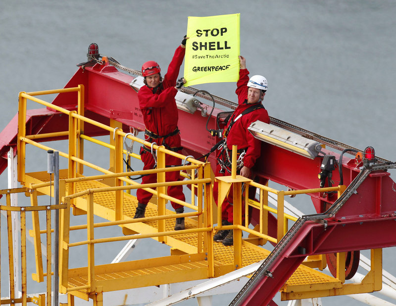 Actress Lucy Lawless, left, joins activists in stopping an oil drilling ship from departing the port of Taranaki, New Zealand.