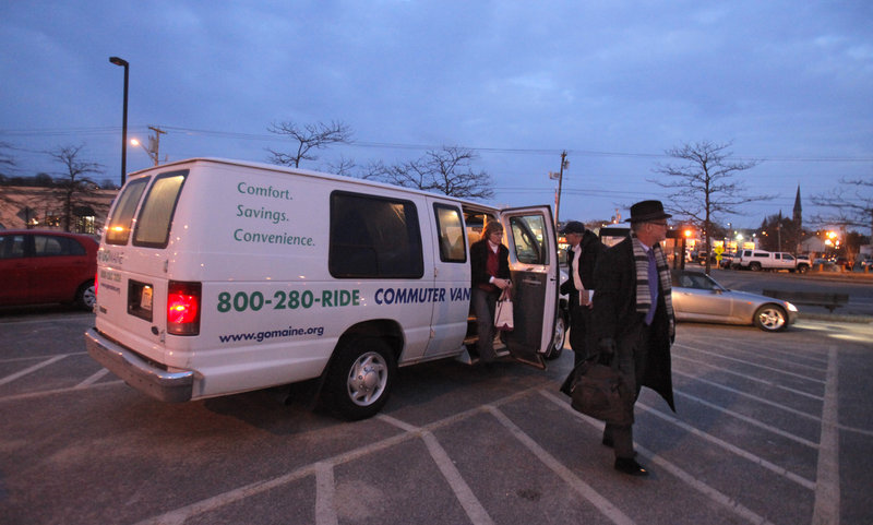 Commuters exit a van Monday at the park-and-ride lot on Marginal Way in Portland. The state is suspending the service, which has been run by Go Maine for the past 10 years.