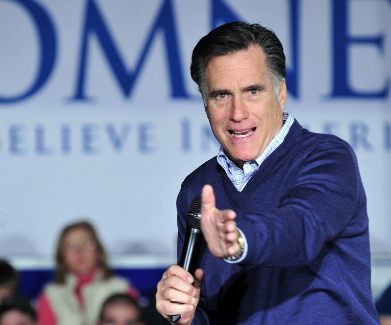 GOP presidential contender Mitt Romney, the former governor of Massachusetts, addresses the crowd at a town-hall meeting at The Portland Co. Marine Complex on Fore Street on Friday night. Romney and one rival, Rep. Ron Paul, R-Texas, will be in Maine today.