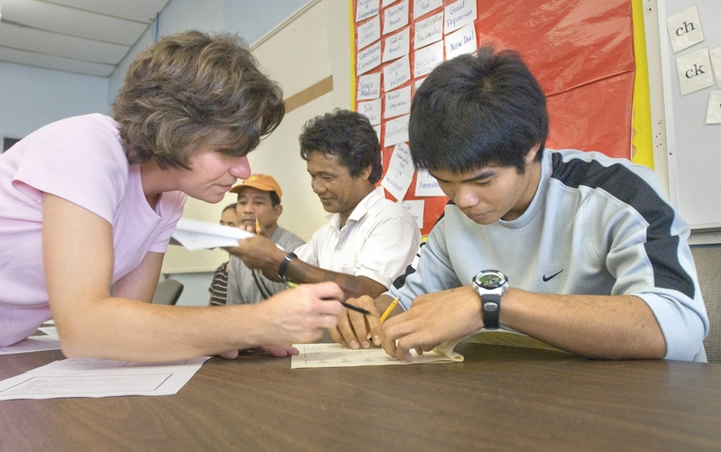 Kathleen Hiscock, a teacher at Portland Adult Education, works with Soe Reh, a refugee from Myanmar, during his first English lesson in 2009. Funding for the English for Speakers of Other Languages program has been cut several times in the past few years.