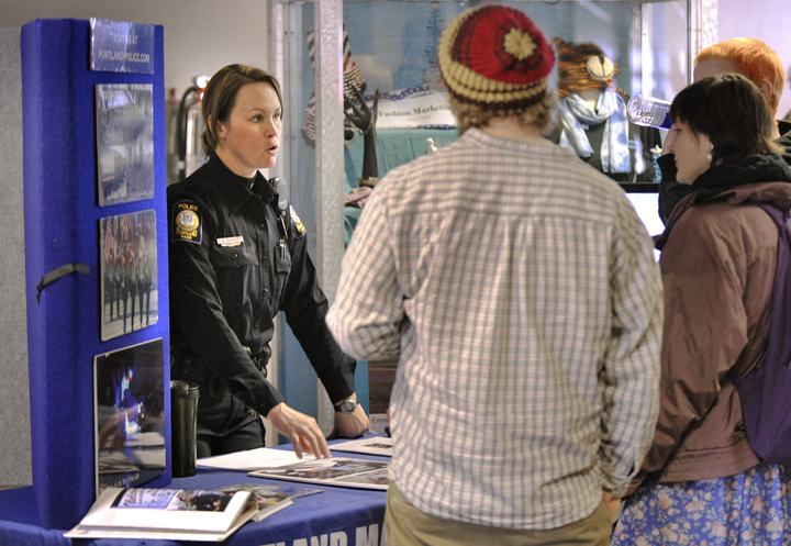 Officer Bethany Murphy discusses employment opportunities within the Portland Police Department during the job fair at PATHS this morning.