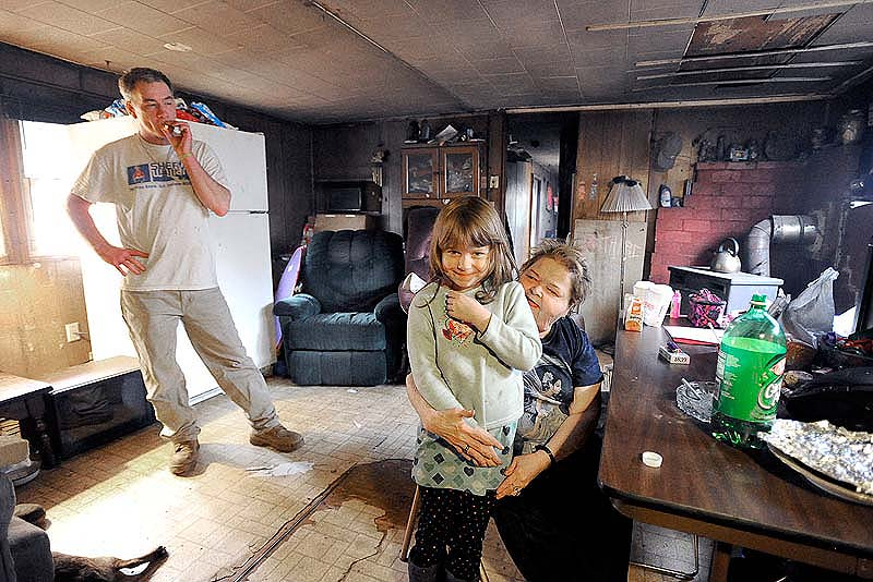 This Friday, March 16 photo shows Robert Chapman, his sister Wendy Turner and her granddaughter, 6-year-old Jadelynn Lee, who were among six people tied up during a home invasion in Steep Falls early Friday morning.