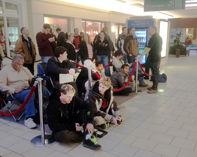 About 50 people wait in line at the Apple Store at the Maine Mall in South Portland this morning to purchase Apple's new iPad. The store opened at 8 a.m. for the special event.