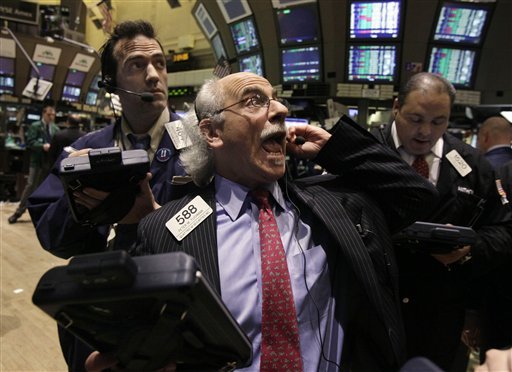 Trader Peter Tuchman, center, works on the floor of the New York Stock Exchange. The Dow Jones industrial average made big gains Monday, rising 162 points. (AP Photo/Richard Drew)