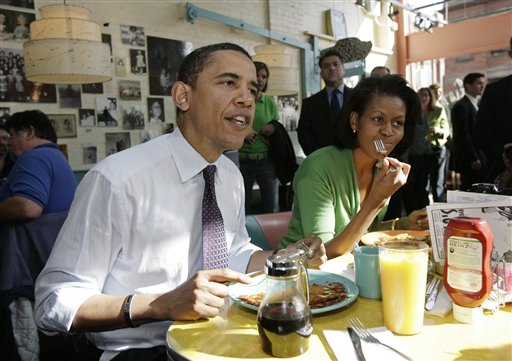 "Then-Democratic presidential hopeful, Sen. Barack Obama, and his wife, Michelle, have breakfast at a diner in Pittsburgh during the 2008 presidential campaign. Nobody's talking about what will be on the menu at Friday's Portland fundraiser for the Obama re-election campaign (though we do know what wines will be served – see ""Heard it through the grapevine,"" below)."