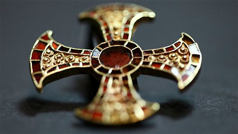 In this undated image made available by the University of Cambridge in England early Friday March 16, 2012, shows a cross. Archaeologists excavating near Cambridge have stumbled upon a rare and mysterious find: the skeleton of a 7th-Century teenager buried in an ornamental bed along with a gold-and-garnet cross, an iron knife and a purse of glass beads. (AP Photo/University of Cambridge)