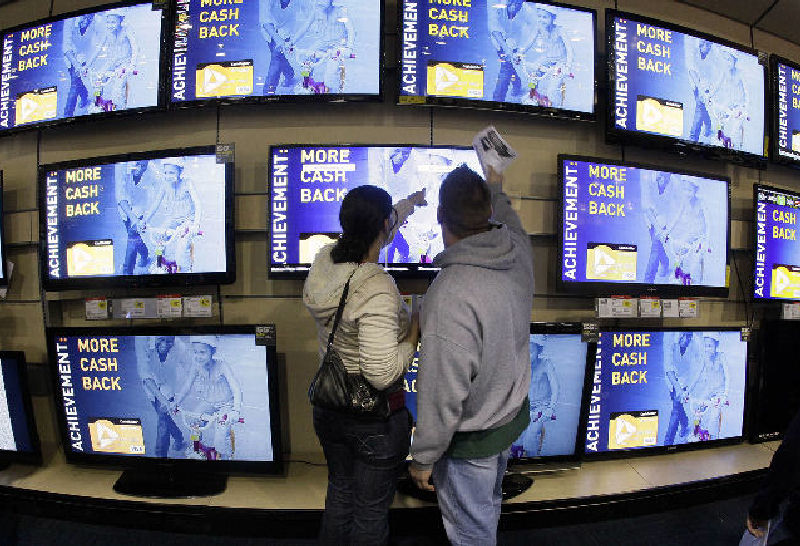 Shoppers look at televisions displayed at a Best Buy in Brentwood, Tenn., recently.
