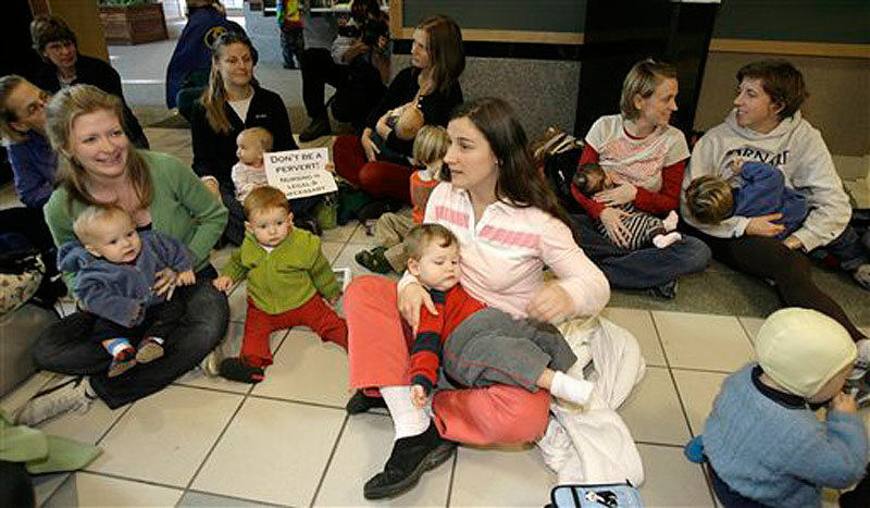 In this Nov. 15, 2006 photo, Jesse Mongeon, center, holds her son Trey, with other protestors at a