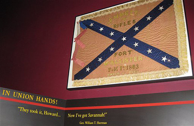 In this Wednesday, March 21, 2012 photo, a Confederate unit flag that belonged to the Emmett Rifles, a Georgia-based company during the Civil War, hangs at Fort McAllister state park in Richmond, Ga., 148 years after the fort fell to Gen. William T. Shermanís army. The flag was captured by a Union officer who left it to his family with a handwritten request that it be returned to Georgia. His great-grandson, Robert Clayton of Islesboro, Maine, donated the flag to the state park, which plans a dedication ceremony in April. (AP Photo/Russ Bynum)