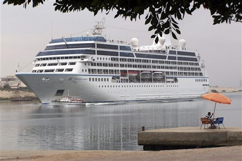 The Azamara Quest sails through the Suez canal, Egypt, in this April 30, 2010 photo on its way to Athens. The fire on the Azamara Quest started late Friday, March 30, 2012 a day after the ship left Manila for Sandakan, Malaysia, and was immediately put out, said coast guard spokesman Lt. Cmdr. Algier Ricafrente. Five crew members were injured. (AP Photo/File)